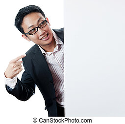 Blank paper for advertisment - Executive male pointing on a...