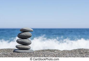 Balance stones on the beach Selective focus