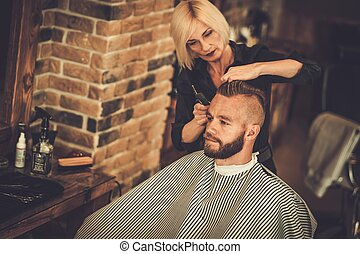 Client visiting hairstylist in barber shop