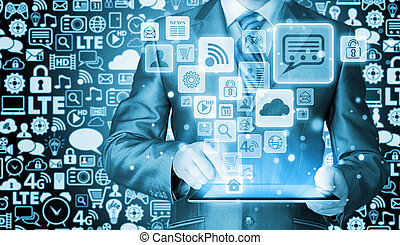 Business man using tablet PC with social media icon set