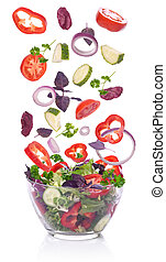 Salad and vegetables for the salad incident isolated on white background