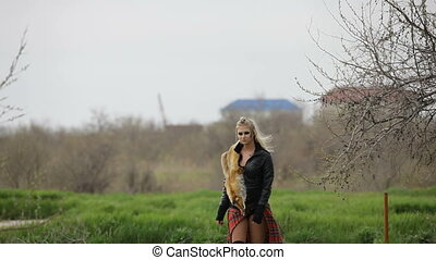 Young Sexy Woman Walking At Park - Two frames. Waist up shot...