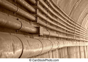 old pipelines aligned into  the tunnel of the subway