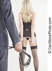 Whip held by dominant master - Leather whip held by dominant...