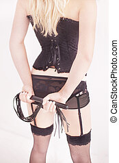 Submissive woman in cuffs waiting for her master