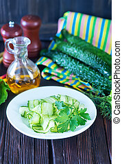salad cucumber on white plate and on a table