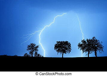 storm in the night - storm with lightning in countryside in...