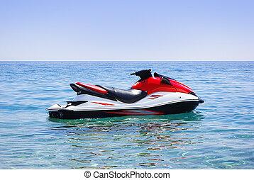 jet ski  - Red jet ski in the sea