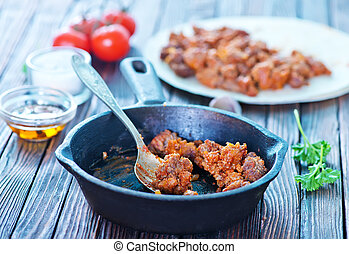 minced meat with tomato sauce in pan