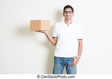 Courier service - Indian man smiling and holding delivery...