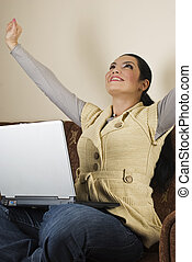 Successful woman using laptop home - Excited woman using...