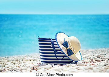 summer background, blue towel on sea beach