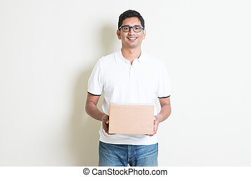 Courier delivery service - Indian man smiling and holding a...