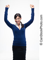Success businesswoman celebrating her winner with arms...