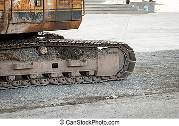Excavator dirty track close up old tractor - Dirty track on...