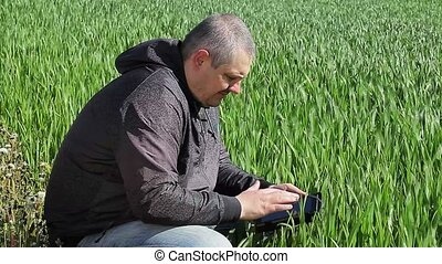 Farmer with tablet PC on cereal