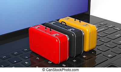 Colorful suitcases on black laptop keyboard with blank...