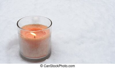 Snow and glass candle - Falling snow and orange color glass...