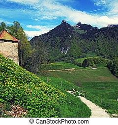 Gruyere Castle,footpath and Alps Mountains, Gruyeres,...
