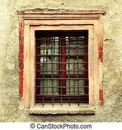 Vintage window on old dirty damaged wall