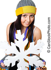 Woman hold huge snowflake and smile, isolated