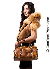 Woman stand with fur and bag - Beautiful woman stand hold...
