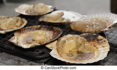 Baked scallops - Soy sauce poured on scallops which baked in...