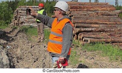 Forest officers filmed near lumber pile in summer