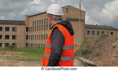 Construction inspector talking on cell phone