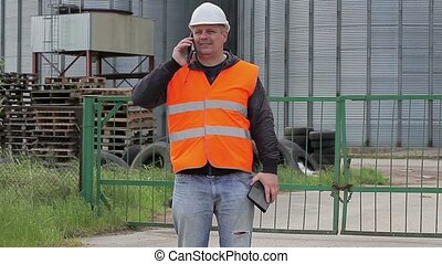 Engineer with cell phone