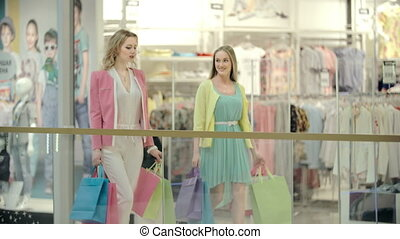 Buying New Clothes - Tracking shot of ladies shopping in the...