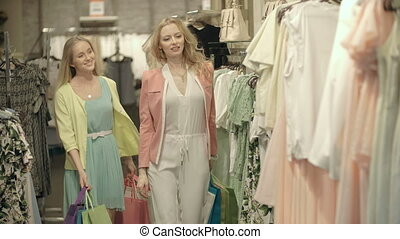 Material Girls - Girls looking at clothes in a store