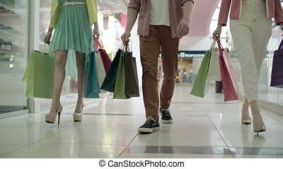 Shopping at the Mall - Low section of three unidentified...