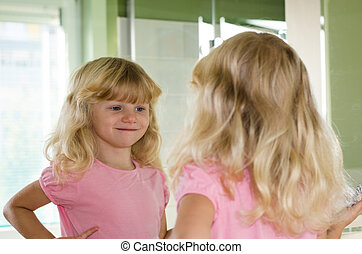 reflection of girl in the mirror