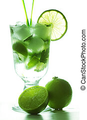 Mojito and limes in counter light against white background
