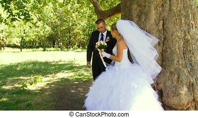 Romantic Kiss The Tree - The young husband whirls the bride...