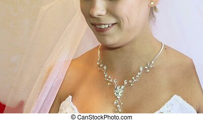 The Bride Wears Jewelry - Close-up Face and neck women...