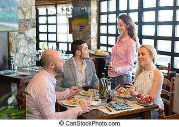 Adults eating out in restaurant