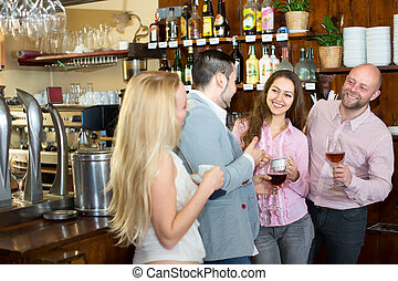 Couples hanging out in a bar