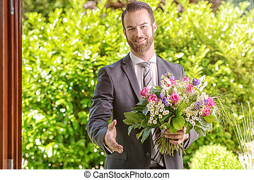 Businessman with Flowers Showing Handshake Gesture -...