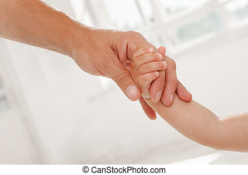 father giving hand to a child - father giving hand to his...