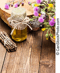 Fresh raw honey and wild flowers - Bottle filled with fresh,...