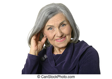 Portrait of a thinking elderly woman on white background