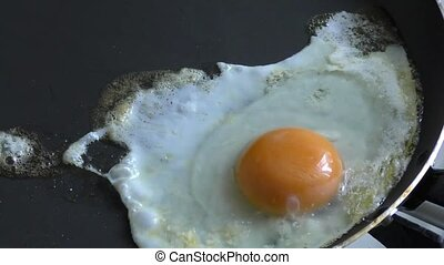 Cooking fried eggs for the morning breakfast