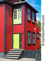 Red house with green door