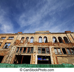 Facade of old destroyed house. Wide-angle view. - Facade of...