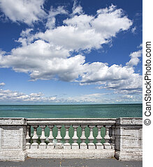Stone White Baluster - empty terrace overlooking the sea...