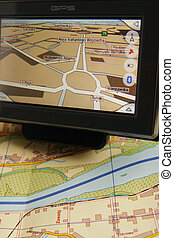 GPS AND MAP - A GPS mobile (navigation device) and old...