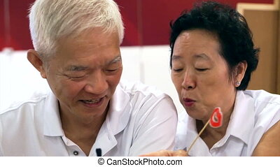 happy senior asian couple playing and have fun with humour