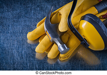 Composition of protective workwear on scratched metallic...